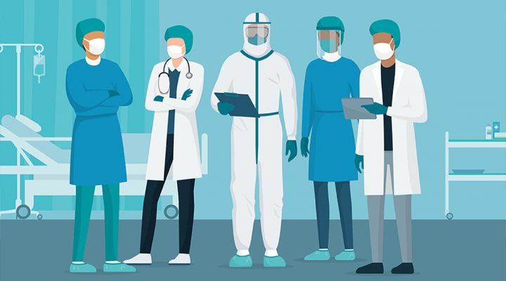 Equipo de enfermeras y profesionales sanitarios en primera línea de lucha contra COVID-19